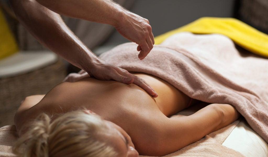 man explaining about massage